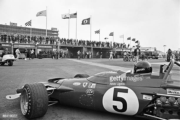 Jackie Ickx tries the Ferrari 312B of Mario Andretti at the Questor Grand Prix at the Ontario Motor Speedway in which Formula One cars competed with...