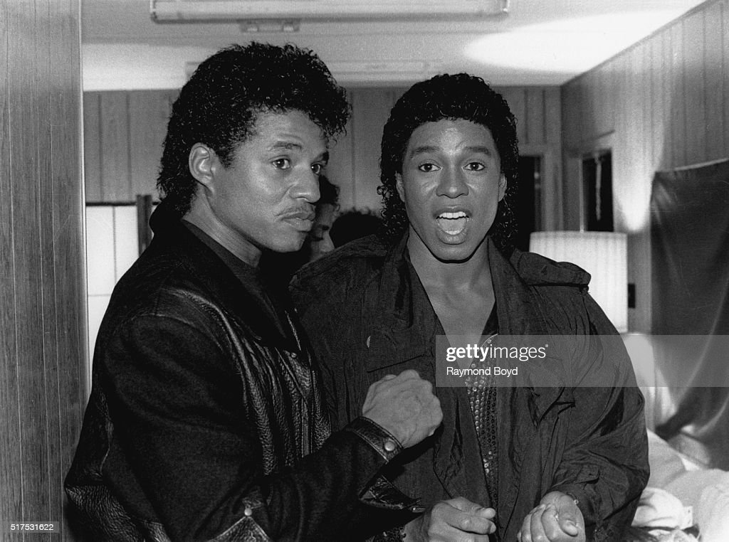 Jackie Jackson and Jermaine Jackson from The Jacksons poses for photos backstage in their trailer prior to going on stage during The Jacksons...