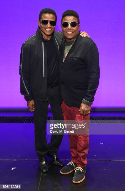 Jackie Jackson and Tito Jackson of 'The Jackson 5' pose with cast members of the West End Production Of 'Motown The Musical' at the Shaftesbury...