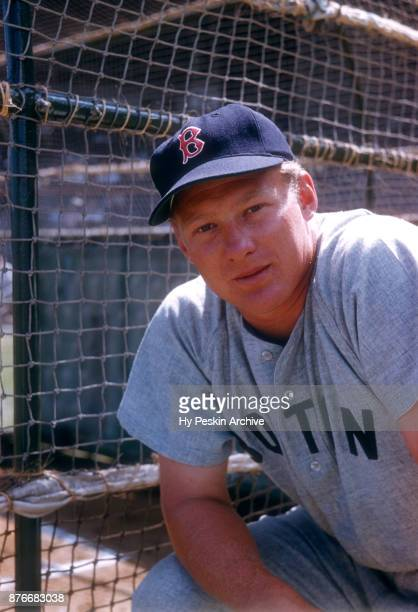 Jackie Jensen of the Boston Red Sox poses for a portrait next to the batting cage before an MLB Spring Training game against the Brooklyn Dodgers...