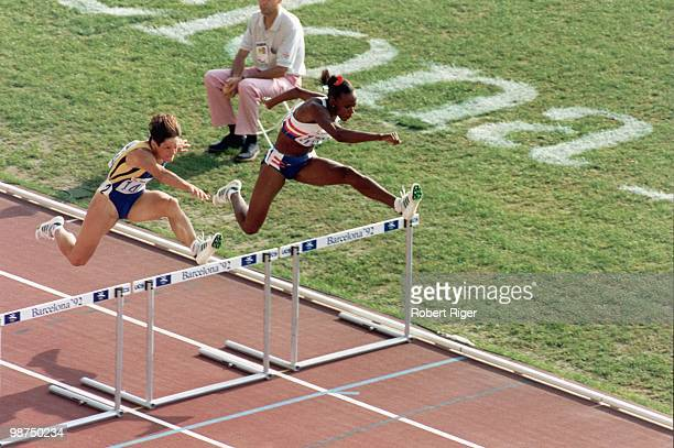 Jackie JoynerKersee of the United States and Liliana Nastase of Romania compete in the 100M Hurdles in the Women's Heptathlon competition during the...