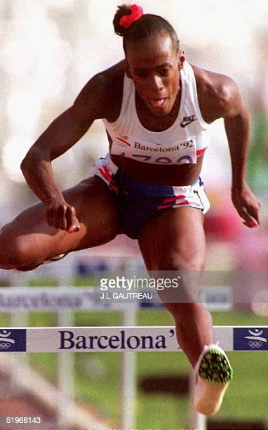 Jackie JoynerKersee of the US is in action to win the heat one of the 100meter hurdles of the women's heptathlon event 01 August 1992 in Barcelona at...
