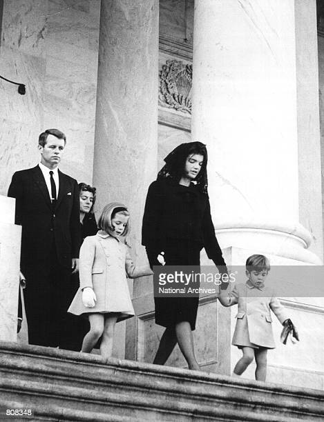 Jackie Kennedy leaves the US Capitol Building with her children John and Caroline after attending a ceremony for her late husband John F Kennedy...