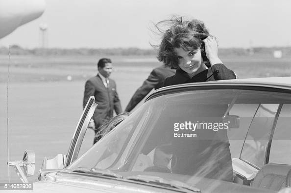 Jackie Kennedy widow of the late President John F Kennedy brushes back her windswept hair She arrived at Barnstable Airport in Hyannis on May 29...