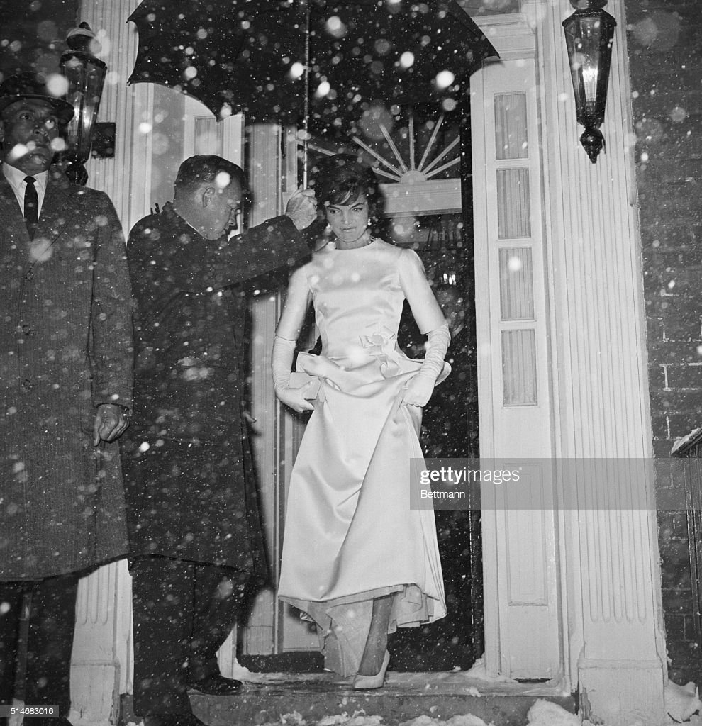 Jackie Kennedy wife of Presidentelect John F Kennedy steps into the snowy nigh from her Georgetown home She is headed for the Inauguration Concert...