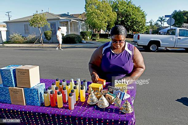 Jackie Lloyd sets up her street vendor booth in Exposition Park in Los Angeles on August 29 2014 She makes ends meet by selling packages of oils shea...