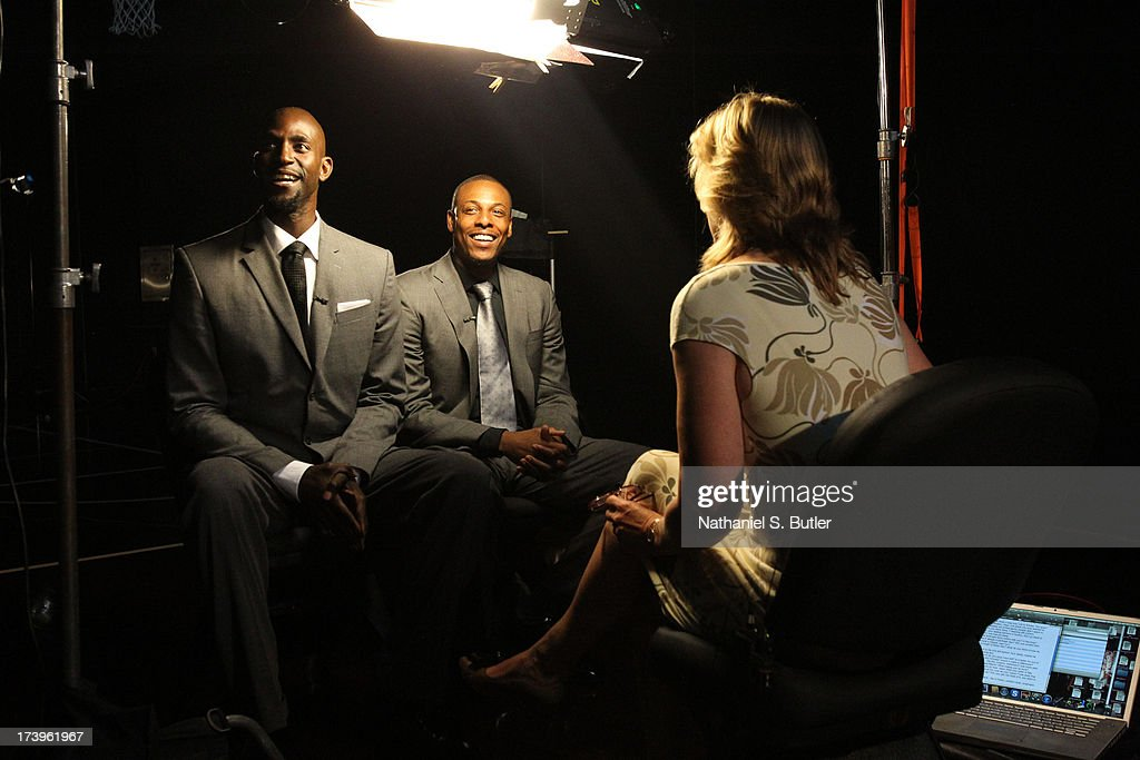Jackie MacMullan of ESPN interviews Kevin Garnett and Paul Pierce of the Brooklyn Nets during a press conference at the Barclays Center on July 18...