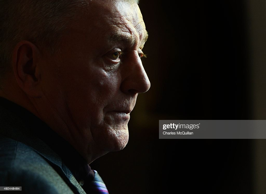 Jackie McDonald, former head of the UDA stands watching the press conference taking place at the launch of the Loyalist Community Council at the Park Avenue Hotel on October 13, 2015 in Belfast, Northern Ireland. The council has the backing of the three main loyalist paramilitary groups, the UVF, the UDA and the Red Hand Commandos. A joint statement from the three loyalist groups said that they are 're-committing to the principals of the Belfast Agreement' and that they 'eschew all violence and criminality'. The launch of the new loyalist community council comes against the backdrop of an ongoing crisis at Stormont following following allegations that the IRA were involved in the murder of their former member Kevin McGuigan.