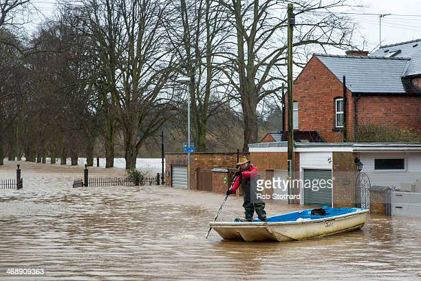 Jackie Morris rows away from her house on Waterworks Road on February 12 2014 in Worcester England The Environment Agency has issued flood warnings...