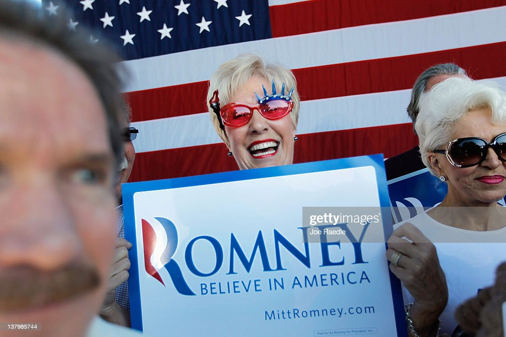 Jackie Nigro shows her suppport for Republican presidential candidate and former Massachusetts Gov. Mitt Romney during his rally with supporters at Pioneer Park on January 30, 2012 in Dunedin, Florida. Romney is campaigning across the state ahead of the January 31 Florida primary.