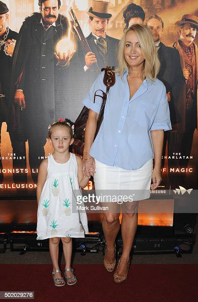 Jackie O and her daughter Kitty arrive ahead of the Illusionists 1903 opening night at Sydney Opera House on December 20 2015 in Sydney Australia
