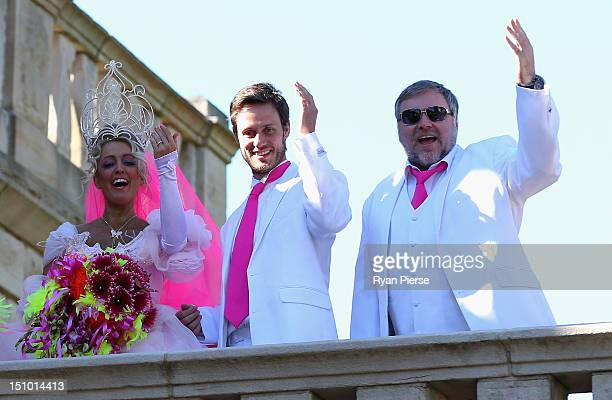 Jackie O Lee Henderson and Kyle Sandilands wave to the crowd during Kyle Jackie O's Big Fat Gypsy Wedding at Curzon Hall Marsfield on August 31 2012...