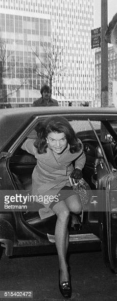 Jackie Onassis shows a lot of leg as she arrives here at the Federal Court where she faced cross examination by veteran attorney Alfred Julian who...