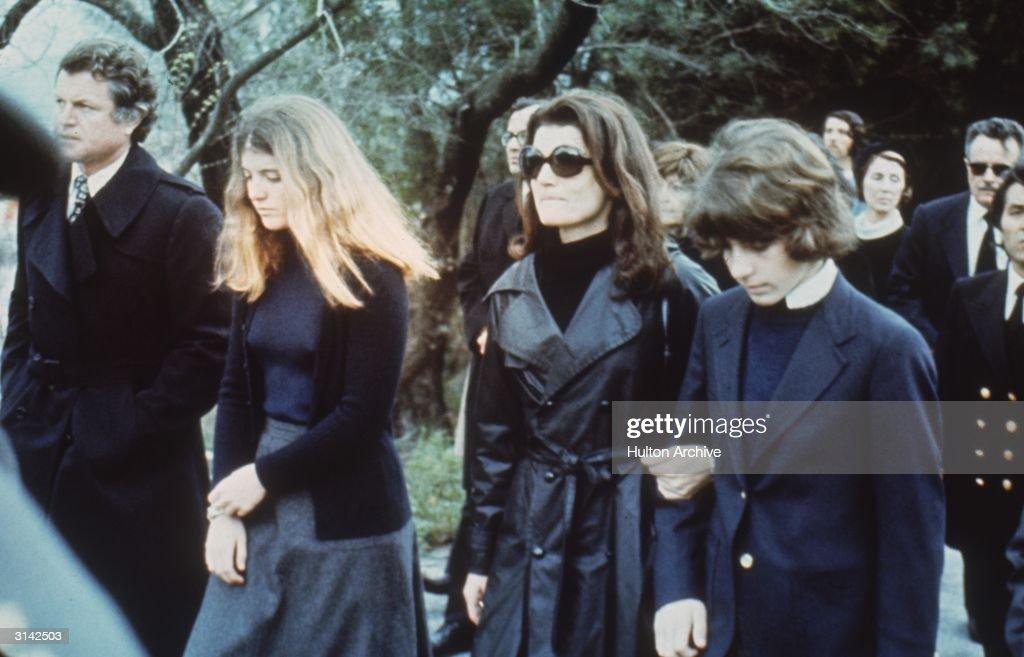 Jackie Onassis (1929 - 1994), the widow of murdered President John F. Kennedy, flanked by her children Caroline and John F. Kennedy Jr. (1960 - 1999) at the funeral of her second husband, Aristotle Onassis on the island of Skorpios. Senator Edward Kennedy accompanies them to the left.