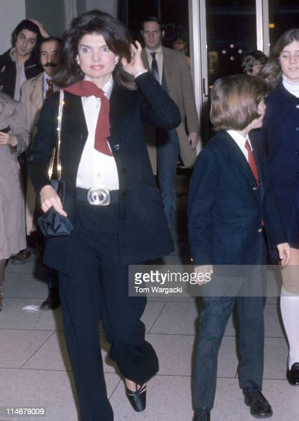 Jackie Onassis with her children John Kennedy Jr and Caroline Kennedy