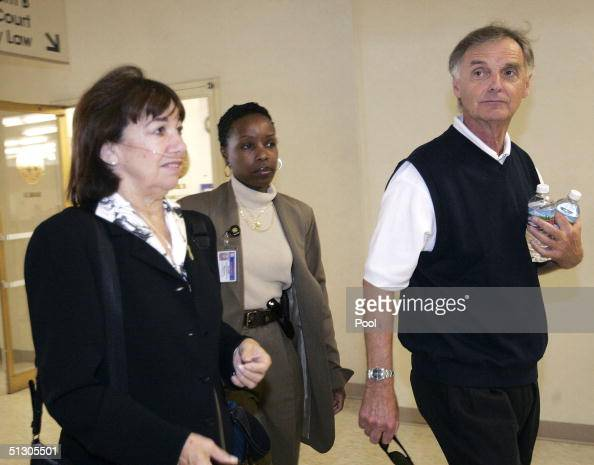 Jackie Peterson and Lee Peterson parents of Scott Peterson along with an unidentified police escort arrive at the courthouse for the trial of Scott...