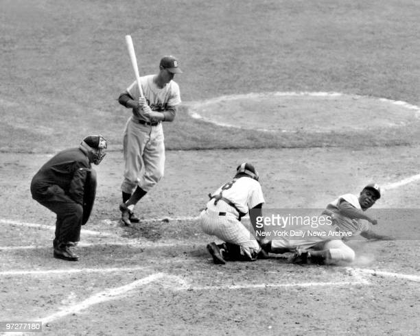 Jackie Robinson Brooklyn Dodgers tries to steal home during World Series against the New York Yankees on September 28 1955 Yankee Catcher Yogi Berra...