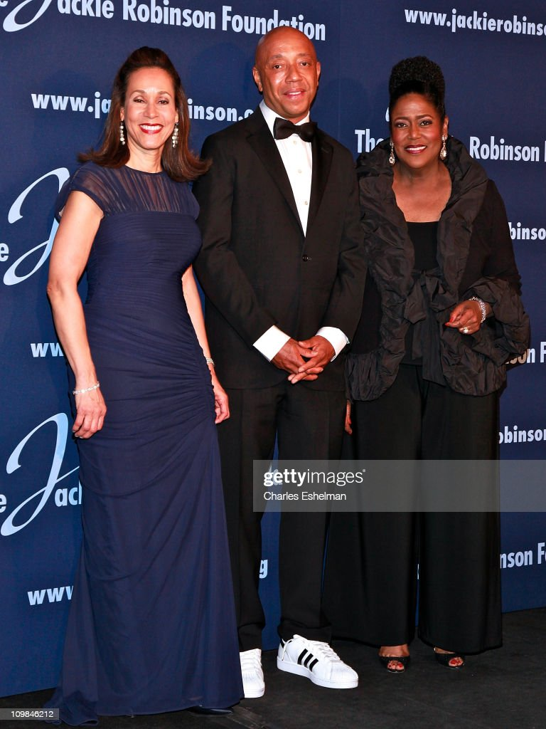 Jackie Robinson Foundation President and CEO Della Britton Baeza presenter Russell Simmons and Senior VP Global Community Connections The Coca Cola...