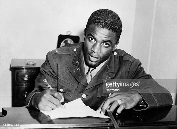 Jackie Robinson in military uniform becomes the first African American to sign with a white professional baseball team He signs a contract with the...