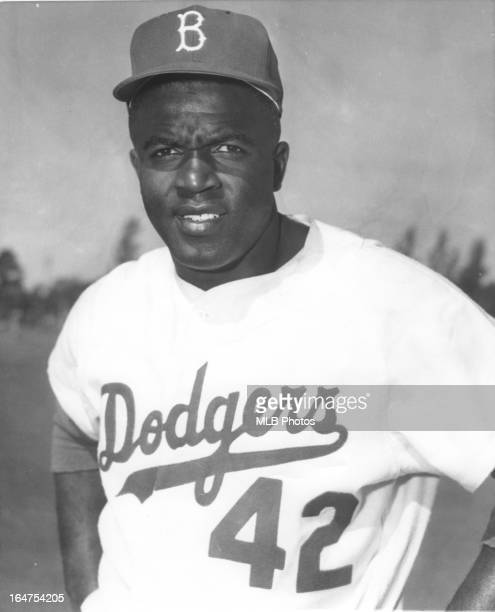 Jackie Robinson of the Brooklyn Dodgers poses for a portrait in an undated and unspecified location