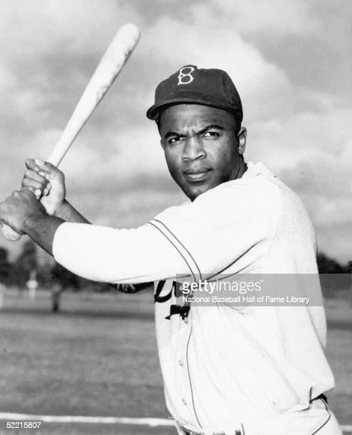 Jackie Robinson of the Brooklyn Dodgers poses for a portrait with his bat Jackie Robinson played for the Dodgers from 19471956