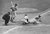 Jackie Robinson of the Dodgers slides home safely on his steal in the eighth inning of this series opener at Yankee Stadium This was the play that...
