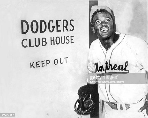 Jackie Robinson the first black to be admitted to the major leagues enters the Brooklyn Dodgers' clubhouse after the Dodgers announced they had...