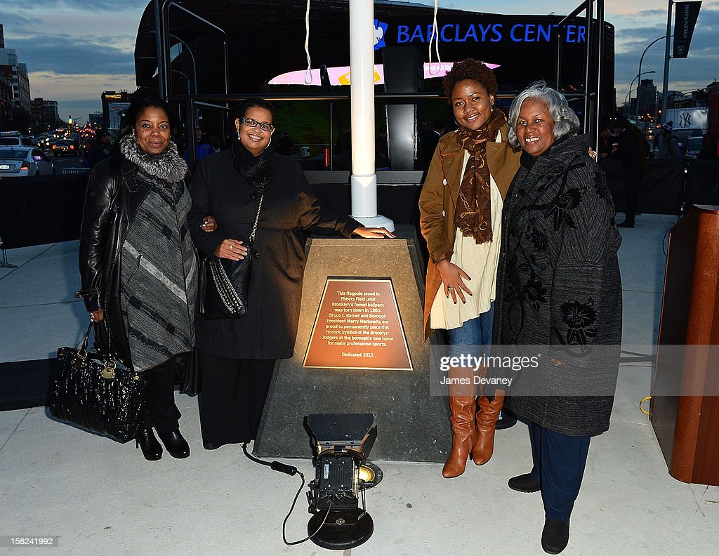 Jackie Robinson's daughter Sharon Robinson (R) and family members attend the Ebbets Field Flagpole Commemoration at the Barclays Center on December 11, 2012 in the Brooklyn borough of New York City.