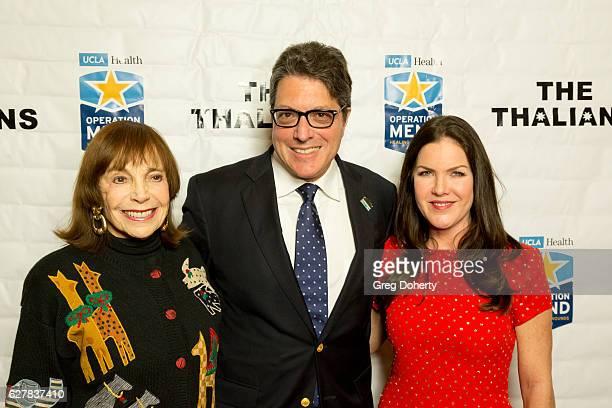 Jackie Rosenberg Beverly Hills Mayor John Mirisch and Actress Kira Reed Lorsch arrive for The Thalians Presidents Club's 'Holiday Brunch Spectacular'...