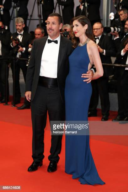 Jackie Sandler and Adam Sandler depart the 'The Meyerowitz Stories' screening during the 70th annual Cannes Film Festival at Palais des Festivals on...