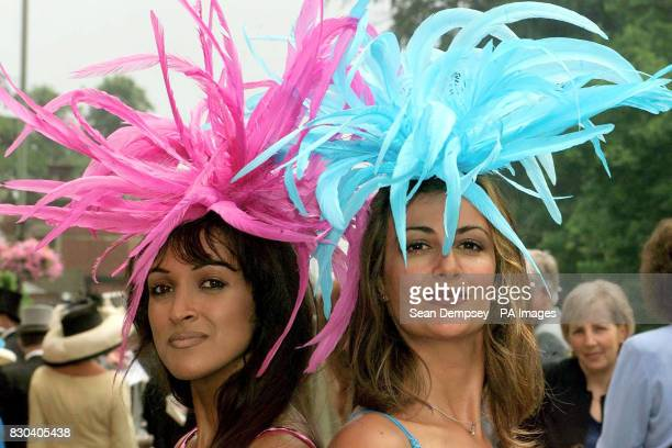 Jackie St Clair and Kimberly Cowell wearing traditional Ascot attire from Fenwicks as the weather brought to an end the short heat wave which pushed...