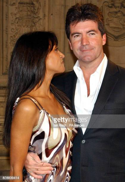 Jackie St Clair and Pop Idol judge Simon Cowell arrive for the annual National Television Awards at the Royal Albert Hall in central London