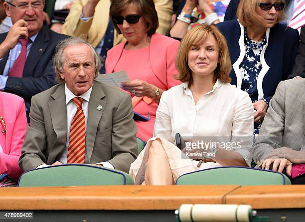 Jackie Stewart and Fiona Bruce attend the Philipp Kohlschreiber v Novak Djokovic match on day one of the Wimbledon Tennis Championships on June 29...