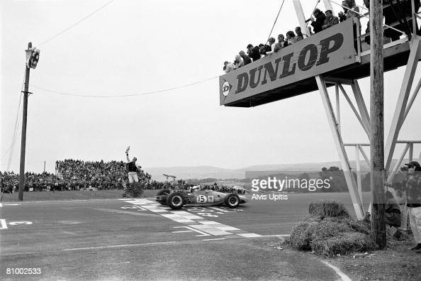 Jackie Stewart and his Matra Ford MS10 cross the finish line and are flagged to victory at the United States Grand Prix held at Watkins Glen New York...