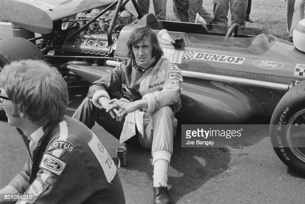 Jackie Stewart sitting next to his car a MarchCosworth 701 before the British Grand Prix held at Brands Hatch on 18th July 1970