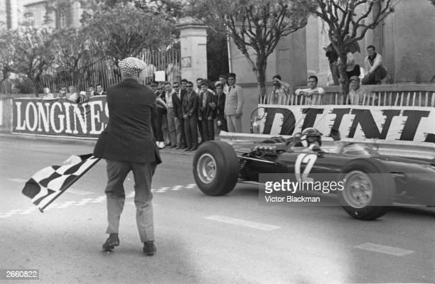 Jackie Stewart taking the checkered flag to win the Monaco Grand Prix