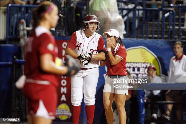 Jackie Traina of the University of Alabama gets some advice from Associate Head Coach Alyson Habetz after hitting a single against the University of...