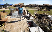 Jackie Watkins shows the storm shelter she and five members of her family survived the tornado May 22 2013 in Moore Oklahoma The twomilewide Category...