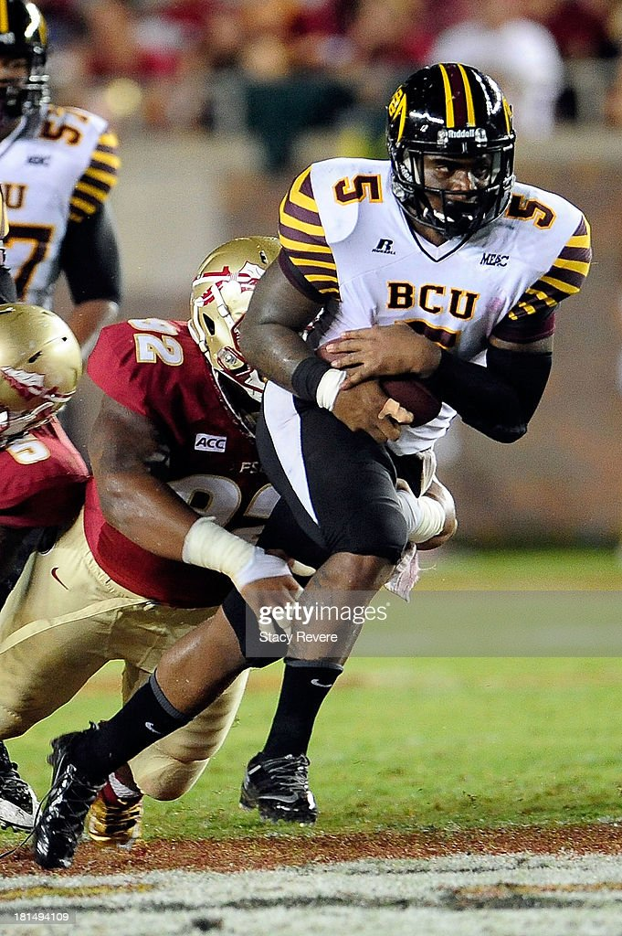 Jackie Wilson #5 of the Bethune-Cookman Wildcats is tackled by Justin Shanks #92 of the Florida State Seminoles during a game at Doak Campbell Stadium on September 21, 2013 in Tallahassee, Florida.
