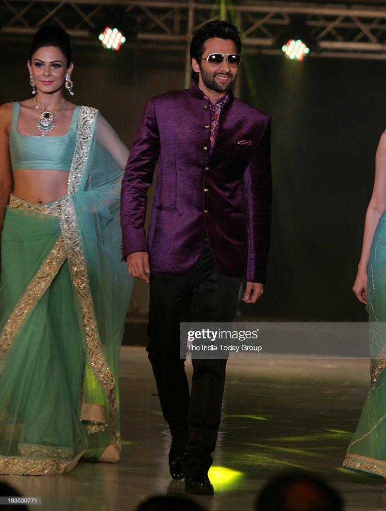 Jackky Bhagnani walks the ramp during a fashion show organised by India International Bullion Summit showcasing exquisite jewellery.