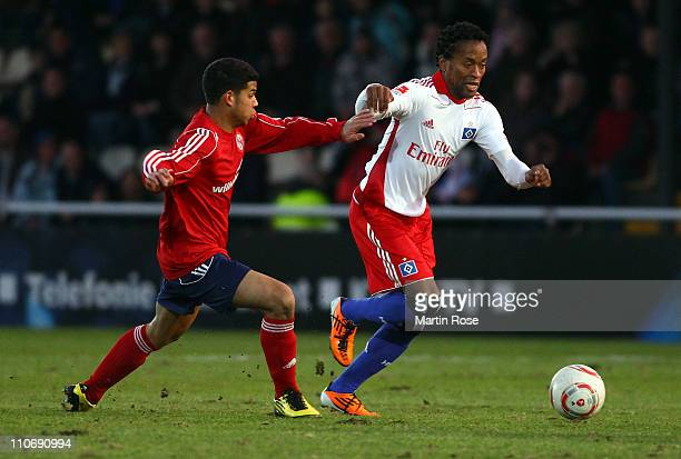 Jackley Brown of Norderstedt and Ze Roberto of Hamburg battle for the ball during the charity match between Eintracht Norderstedt and Hamburger SV at...