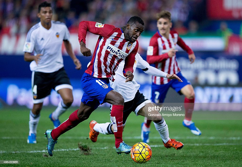 Jackson Arley Martinez (L) of Atletico de Madrid competes for the ball with Aderllan Santos (R) of Valencia CF during the La Liga amtch between Club Atletico de Madrid and Valencia CF at Vicente Calderon Stadium on October 25, 2015 in Madrid, Spain.