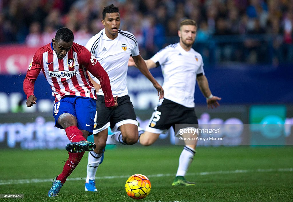 Jackson Arley Martinez (L) of Atletico de Madrid scores their opening goal during the La Liga amtch between Club Atletico de Madrid and Valencia CF at Vicente Calderon Stadium on October 25, 2015 in Madrid, Spain.