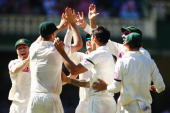 Jackson Bird and Mitchell Johnson of Australia celebrate with their team mates after combining to take the wicket of Lahiru Thirimanne of Sri Lanka...