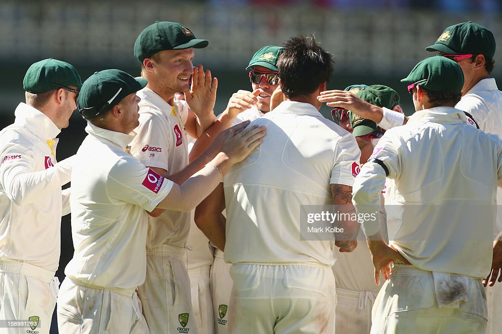 Jackson Bird and Mitchell Johnson of Australia celebrate with their team mates after combining to take the wicket of Lahiru Thirimanne of Sri Lanka during day three of the Third Test match between Australia and Sri Lanka at Sydney Cricket Ground on January 5, 2013 in Sydney, Australia.