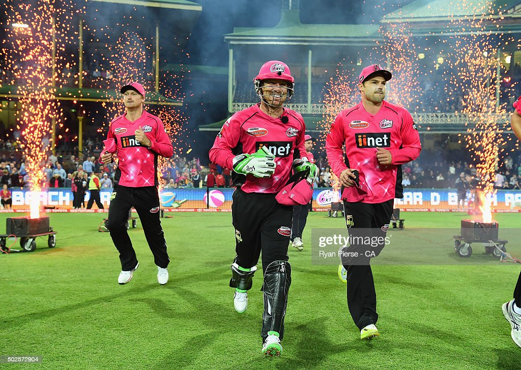 Jackson Bird, Brad Haddin and Michael Lumb of the Sixers run out to field during the Big Bash League match between the Sydney Sixers and the Melbourne Stars at Sydney Cricket Ground on December 27, 2015 in Sydney, Australia.