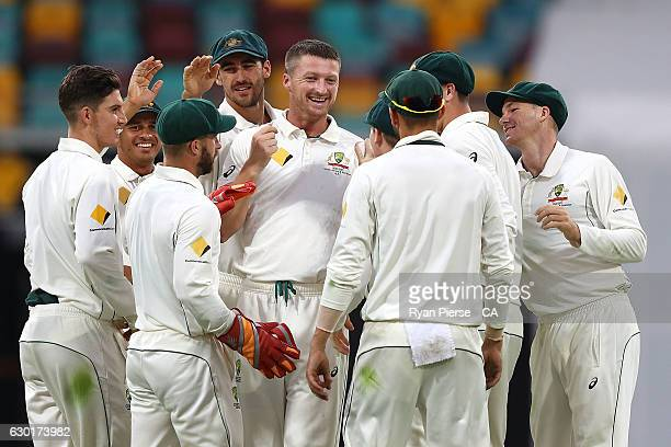 Jackson Bird of Australia celebrates after taking the wicket of MisbahulHaq of Pakistan during day four of the First Test match between Australia and...