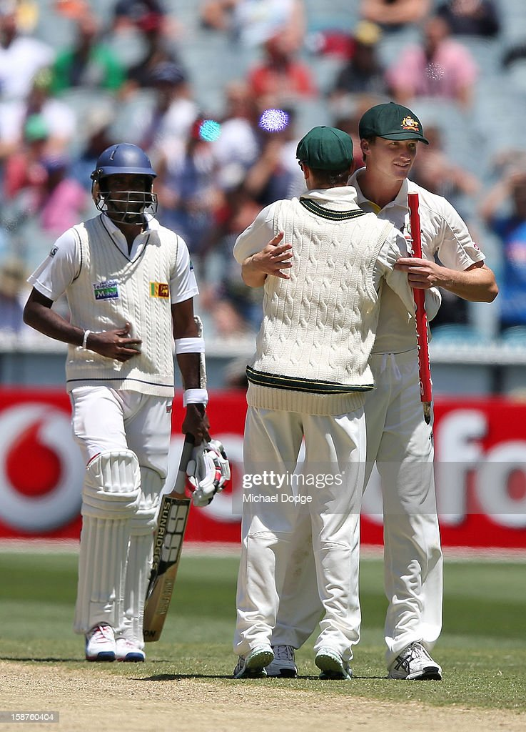 Jackson Bird (R) of Australia celebrates the win with Nathan Lyon during day three of the Second Test match between Australia and Sri Lanka at Melbourne Cricket Ground on December 28, 2012 in Melbourne, Australia.