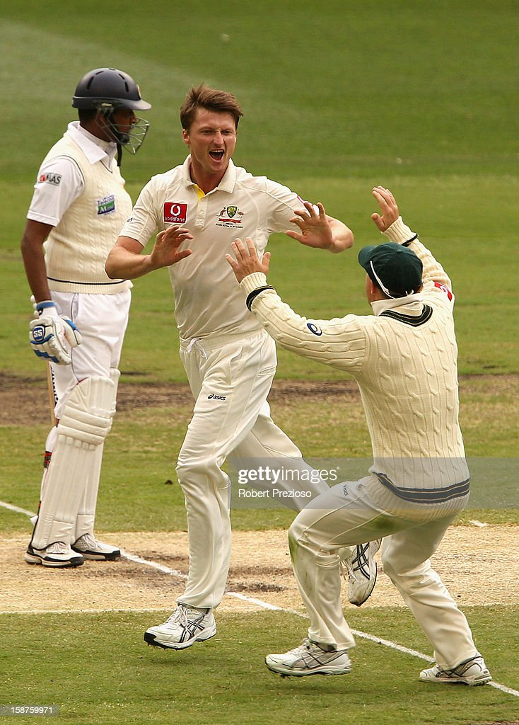 <a gi-track='captionPersonalityLinkClicked' href=/galleries/search?phrase=Jackson+Bird&family=editorial&specificpeople=8665256 ng-click='$event.stopPropagation()'>Jackson Bird</a> of Australia celebrates with David Warner the wicket of Thilan Samaraweera of Sri Lanka during day three of the Second Test match between Australia and Sri Lanka at Melbourne Cricket Ground on December 28, 2012 in Melbourne, Australia.