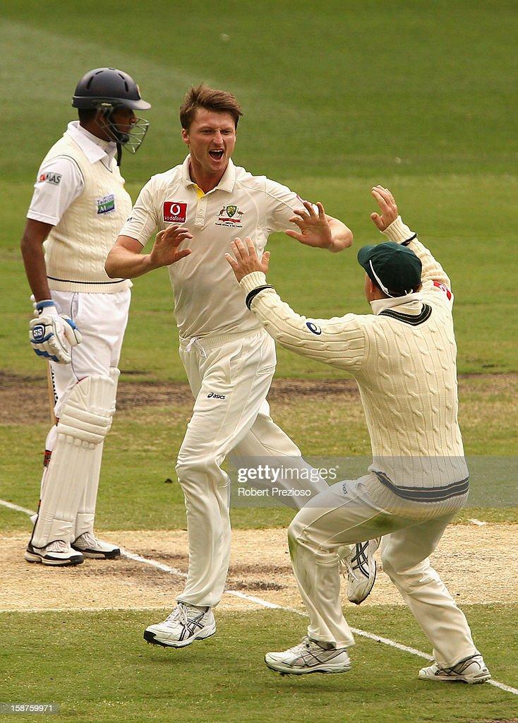 Jackson Bird of Australia celebrates with David Warner the wicket of Thilan Samaraweera of Sri Lanka during day three of the Second Test match...